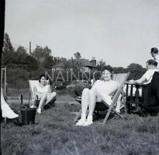 2 Original photo negatives - 2 ladies in deck chairs - poss wearing tennis shoes