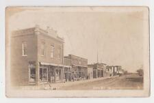 RPPC,Shelby,IA.Main Street,West Side,Gen.Merchandise,Masonic Hall,Barber,c.1912