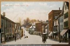 1909 DEXTER, MAINE ME Street Scene with Stores in Winter Snow Unused Postcard