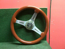 "Grant GT steering wheel and center woodgrain look 14"" Used. Couple stress cracks"