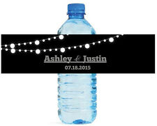 Black background and white glowing Market Lights Wedding Water Bottle Labels