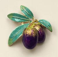 Unique vintage style Olive brooch in enamel on metal.
