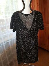 Tolles Stretch Kleid mit Wickeloptik, schwarz/weiß, Gr. 48/50