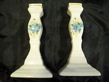 ONE PAIR OF BEAUTIFUL CANDLE HOLDERS 7 INCHES TALL EARTH TONES W/BLUE FLOWERES