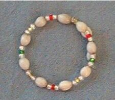 Bracelet: White Hawaiian Job's Tears and clear, red, green and yellow seed beads