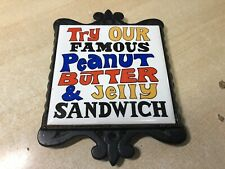 "Vintage Cast Iron & Ceramic ""Try Our Famous PB&J Sandwich"" Trivet"