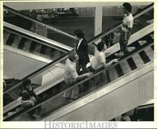 Press Photo Customers Walking on Escalators at Montgomery Ward - saa76984