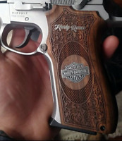 Smith & Wesson 5906 grips Walnut wood and harley Davidson logo made of silver.