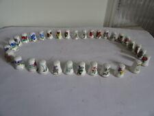 collection 34 dés porcelaine décor de fleurs en parfait état