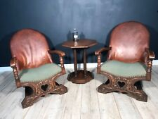 Antique carved French leather chairs with love heart detail