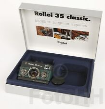 """ROLLEI 35 """"BLACK MAGIC"""" IN SILVER WITH GREEN LEATHER AND WITH SERIALNUMBER :1001"""