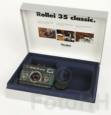 "ROLLEI 35 ""BLACK MAGIC"" IN SILVER WITH GREEN LEATHER AND WITH SERIALNUMBER :1001"