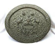 Antique Indian brass oval tray or plaque, repoussé deity, elephants, sun, moon