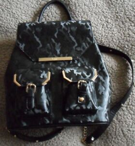 Dune  back pack  black glossy with gold details brand new