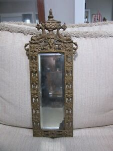 Vintage, ornate brass frame, mirror. N. B & I.W. CO. Nautical dolphins