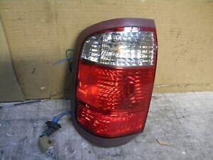 2002 Infiniti QX4  Factory Tail light left driver side brake light assembly lens