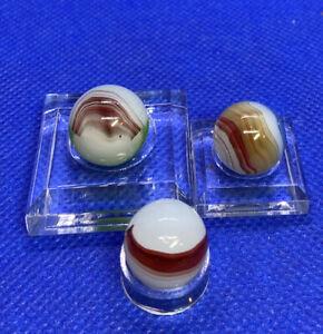 Three Oxblood Marbles