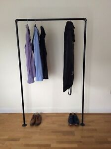 Industrial clothing shelf made from galvanized iron in black.