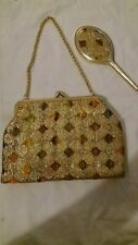 Gold patterned evening handbag with mirror