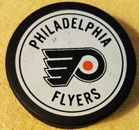 VINTAGE PHILADELPHIA FLYERS NHL USED HOCKEY PUCK CANADA OLD GENERAL TIRE SLUG