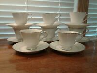TWO SETS OF 4 EACH CROWN EMPIRE CHINA PRINCESS PATTERN FOOTED CUPS AND SAUCERS