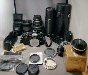 Nikon FA 35mm Camera w/ 4 lenses, auto winder, flash, filters.          HUGE LOT