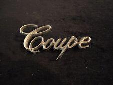 """1970's  """"Cadillac"""" Coupe DeVille (COUPE) Rear Fender Emblem  part number 9691395"""