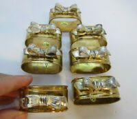 Set of 6 plus 1 extra Oval Napkin Rings heavy Brass With Silver Metal Bows