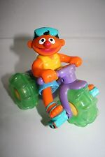 Sesame Street's Ernie Riding a Big Three Wheeler Push Toy