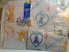 2 carebear packages of gift wrap nip