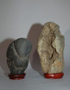 Two fertility stones, male and female genitals, on wooden stands, Japan