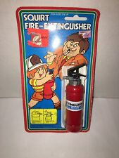 "Squirting Fire Extinguisher toy, approx. 4.5"" tall"