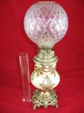 lampe à pétrole faience décorée globe bronze