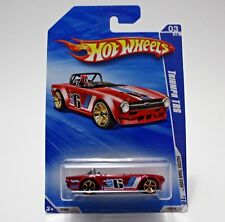 Hot Wheels Red Triumph TR6 2010 Faster Than Ever R7556 129/214 03/10 NEW IN BOX