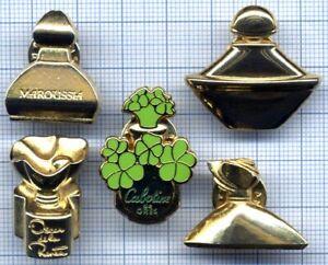 Lot de Pin's parfums dorés Guerlain OSCAR DE LA RENTA Cabotine MAROUSSIA PERFUME