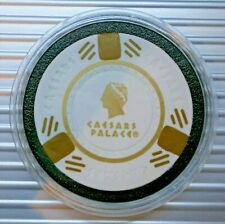 CAESARS PALACE POKER CHIP CARD GUARD - CHIP IN PLASTIC CAPSULE