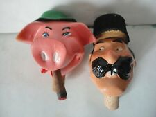Bouchons anciens en plâtre plastique cochon homme