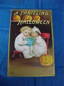 Early 20thc HALLOWEEN Ellen CLAPSADDLE POSTCARD -Kids READING GHOST STORY BOOK