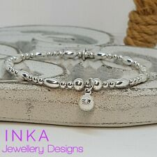 Inka 925 Sterling Silver stretch beaded Stacking Bracelet with a Bell charm