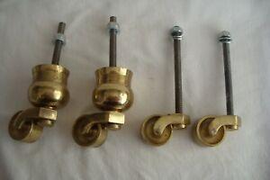 Set Of Four Vintage Brass Furniture Castors.