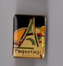 pin's maroquinerie / Paquetage Paris (tour Eiffel stylisée)