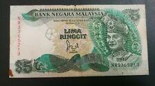 (RM) Malaysia  5 Ringgit Jaffar Hussain. FIRST PREFIX. VF