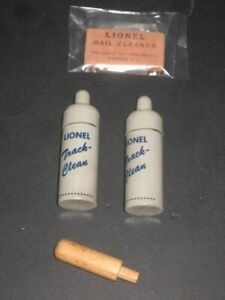 2  LIONEL TRACK CLEANING BOTTLES PLUS ONE RUBBER RAIL CLEANER & ONE WOOD TAMPER