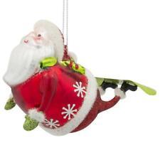 Santa on a Snowboard Skating Glass Christmas Ornament