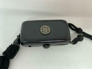 ART DECO CELLULOID COMPACT WITH DIAMONTES AND TASSEL