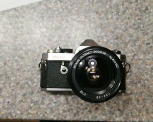 Pentax MX SLR camera + Braun Ultralit Zoom 28-70mm 1:3.4-4.8 MC lens