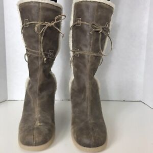 NWOB Michael Kors Size 8.5M Brown Snowflake Shearling Pull On Rubber Wedge Boot