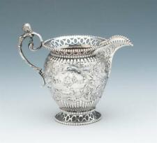Antique Silver Netherlands cream pitcher, with ornate design and Figurals 83.5%