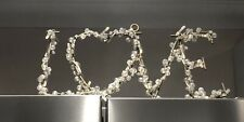 NEXT Light Up LOVE Metal Sign Stand with Beads illuminated by AA batteries