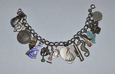 VINTAGE STERLING SILVER CHARM BRACELET WITH 16 CHARMS